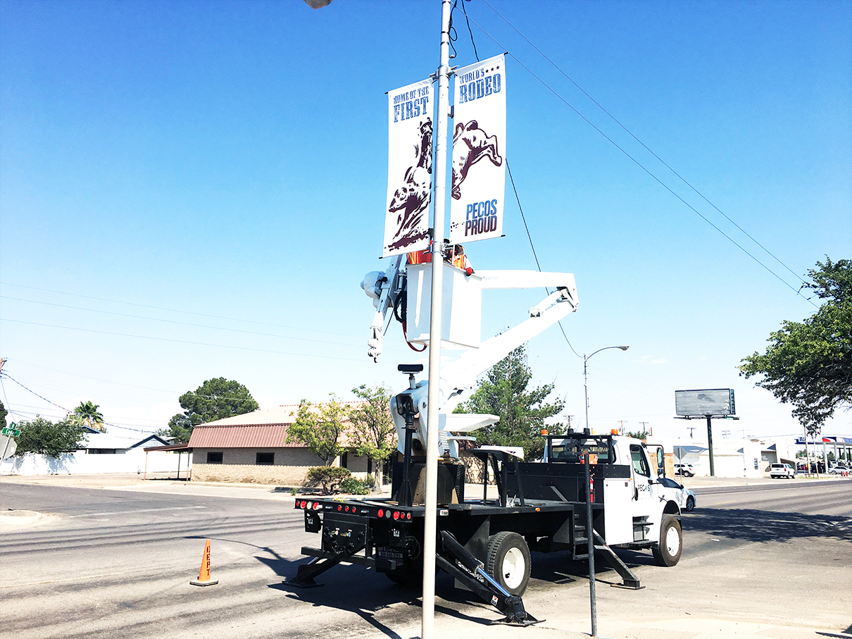 Lets Rodeo!! Parks Crews install banners on Cedar St.